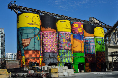 """The """"Giants"""" mural by Gustavo and Otavio Pandolfo, collectively known as OSGEMEOS. It is the biggest public art piece of their career. Photo courtesy of roaming-the-planet."""