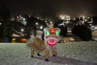 Lion dancer in front of Cowboy