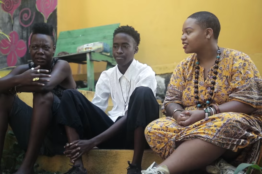 Moni Tep (right) interviews LGBTQ youth in Jamaica. (Screenshot of video by JetBlue Airways.)