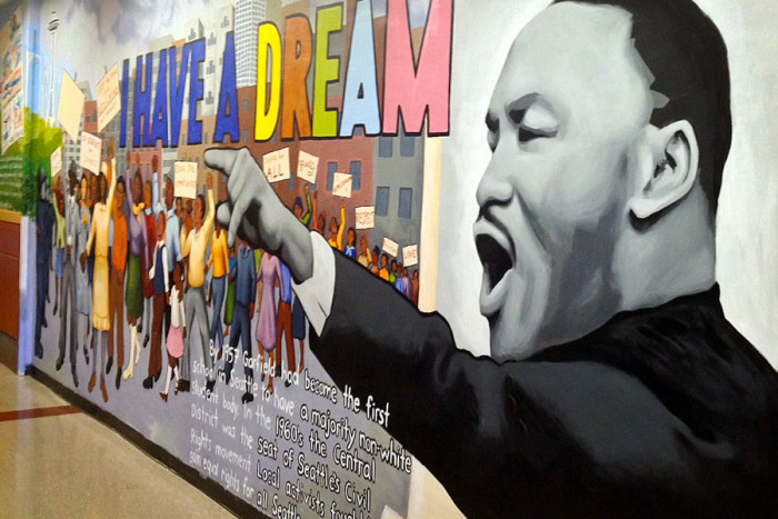 A mural celebrating Dr. Martin Luther King, Jr. adorns the halls of Garfield High School. (Photo from Flickr by Joe Wolf)