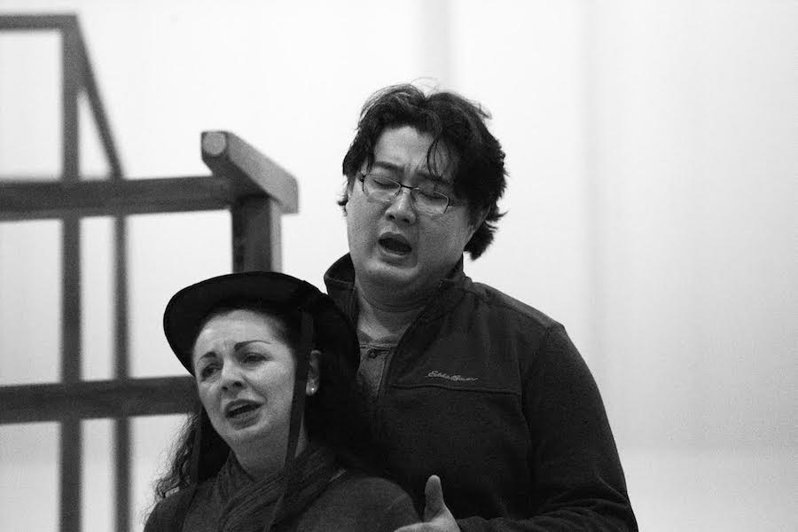 """Nuccia Focile (Susanna) and Shenyang (Figaro) during a staging rehearsal for Seattle Opera's upcoming production of """"The Marriage of Figaro.""""  (Photo by Philip Newton)"""