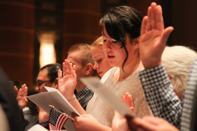 Liliana Caracoza takes the oath of citizenship at a ceremony in Tacoma in September 2014. (Photo by Alex Stonehill)