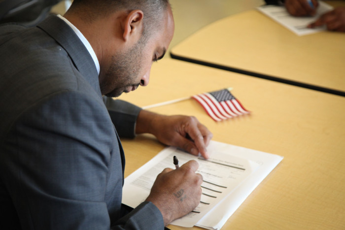 As soon as you're sworn in, you can register to vote. (Photo by Alex Stonehill)