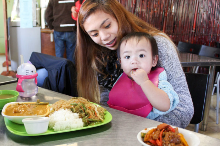Rosa Marquez and her one-year-old daughter Rylee enjoy a lunchtime meal at Inay's. (Photo by Venice Buhain.)