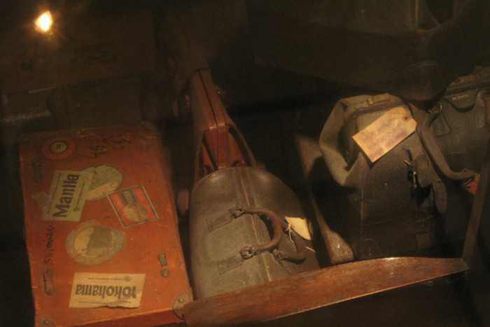 Luggage left behind by interned Japanese-Americans, on display through the floor of the Panama Hotel. (Photo by Sihanouk Mariona)