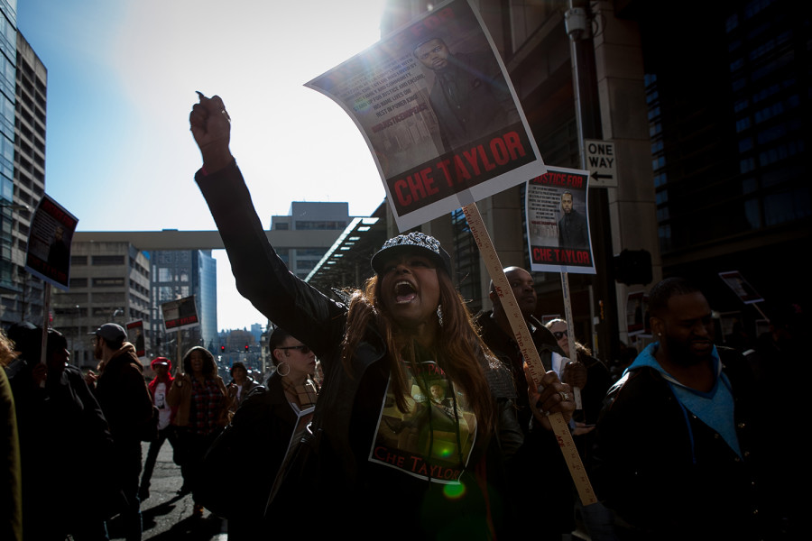 Demonstrators marched from SPD's downtown headquarters to the Federal District Courthouse. (Photo by Jovelle Tamayo.)