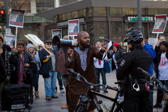 Andre Taylor asks Seattle police officers if they believe in justice for all people on February 25, 2016 at a demonstration for his brother, Che Taylor, who was shot and killed Sunday by Seattle Police. (Photo by Jovelle Tamayo.)