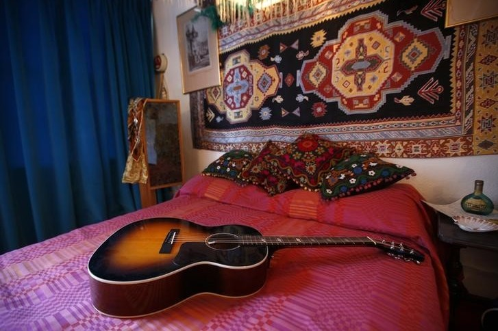 Replica items, including a guitar, in the bedroom of the home where Jimi Hendrix and girlfriend Kathy Etchingham lived in 1968-69  London, February 8, 2016. (Photo by Peter Nicholls for Reuters.)