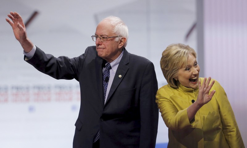 Bernie Sanders and Hillary Clinton at the Democratic presidential candidates' debate in Milwaukee, in early February. (Photo from REUTERS/Jim Young)
