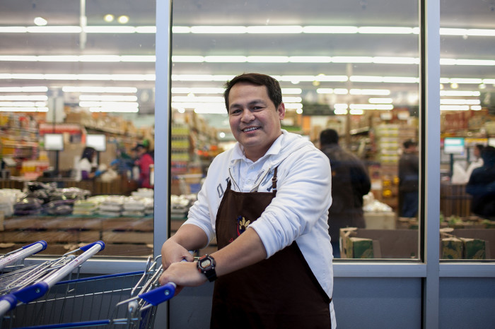 Store manager Raffy Azeron poses for a portrait outside Island Pacific Market, a Filipino-inspired grocery store in Seattle's Rainier Valley. (Photo by Jovelle Tamayo.)