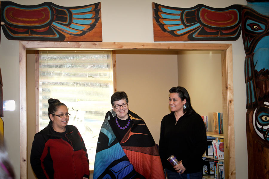 UW president Ana Mari Cuace is presented with an honorary blanket by Lummi tribal member Luanne Wilson. (Photo by Sharayah Lane)