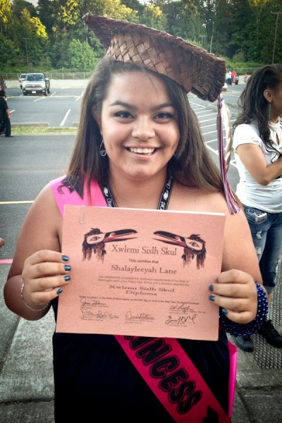 Holding up the first high school diploma in our family, Shalayleeyah Lane celebrates her graduation from Lummi Nation High School. (Courtesy photo)