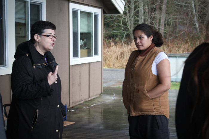 Lummi Tribal member Nannett Martin (right) discusses the workings of the Lummi Nation Shellfish Hatchery to UW president Ana Mari Cauce. (Photo by Sharayah Lane)