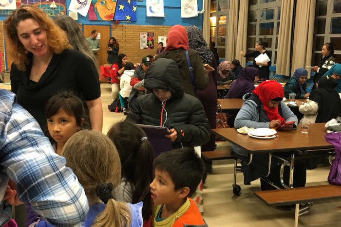 Parents gather at Graham Hill Elementary School at an event on Dec. 8. (Photo by Nimco Bulale/OneAmerica)