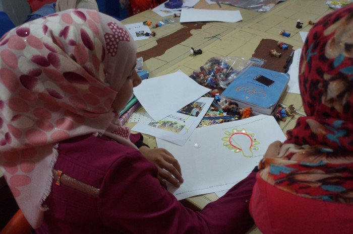 Teens work on their Magic Genius Device designs during a workshop at Za'atari Refugee Camp in Jordan in November 2015. (Photo courtesy of Brian Tomaszewski, Rochester Institute of Technology)