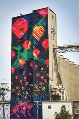 "The ""Bayview Rise"" mural by Seattle artists Laura Haddad and Tom Drugan, on a decommissioned silo facility in San Francisco that's structurally similar to Pier 86. (Photo from Flickr by Aaron Muszalski)"