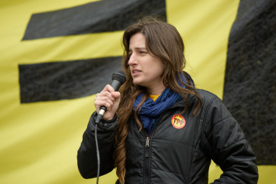 Gillian Locascio, lead organizer for the Washington State Fair Trade Coalition, speaks out against the TPP at the February 3rd rally. (Photo by Rick Berry)