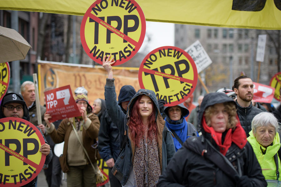 Seattleites gathered on Feb 3rd to protest the signing of the Trans-Pacific Partnership. The agreement still needs to be ratified by member countries. (Photo by Rick Barry)