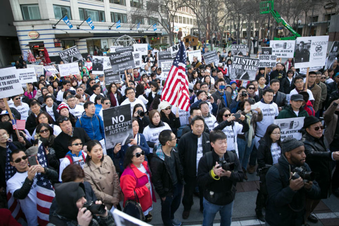 Hundreds of people gathered in Seattle to support former New York City police officer Peter Liang, who was convicted by a jury of manslaughter in the shooting death of Akai Gurley. (Photo by Alex Garland)
