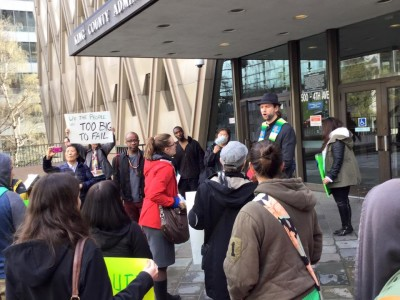 V&M Convener John Helmiere speaking during Turning the Tables solidarity action for Belgrano.(Courtesy of SAFE via facebook)