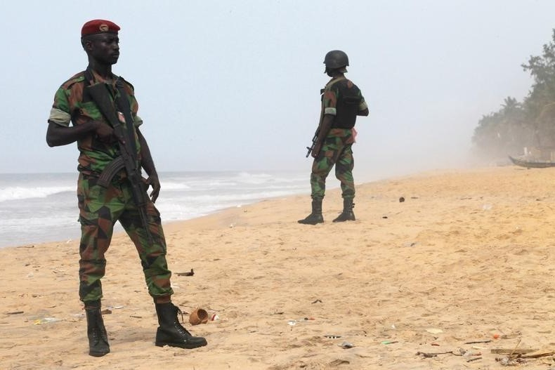 Soldiers stand guard on the beach following an attack by gunmen from al Qaeda's North African branch, in Grand Bassam, Ivory Coast, March 14, 2016.(Photo by Luc Gnago for Reuters)