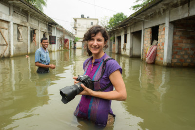 National Geographic Photographer Ami Vitalie, covering flooding and the threat of rising sea levels in Bangladesh. (Courtesy photo by Michael Davie)