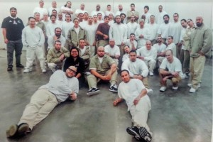 The organization Formerly Incarcerated Group Healing Together, or F.I.G.H.T., offer mentoring, support and political education  to incarcerated men of Asian or Pacific Islander descent. The photo shows leaders and participants at Coyote Ridge Correctional Center in Eastern Washington. (Courtesy photo.)