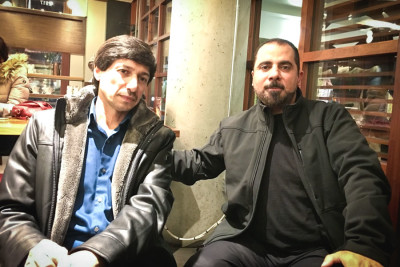 Yahya Algarib and Mushtak Jabbar, both refugees from the first Gulf War who now live in the Seattle area. (Photo by Shahd Bani-Odeh)