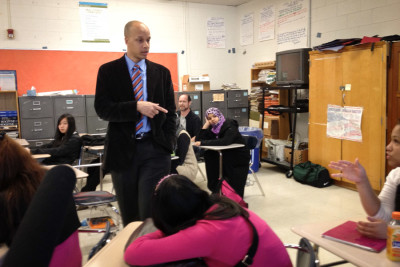 Rainier Beach principal Dwane Chappelle talks to sophomores about the IB program in 2012. Since implementing the advanced curriculum, the school has seen a dramatic increase in graduation rates. (Photo by Gabriel Spitzer / KPLU)