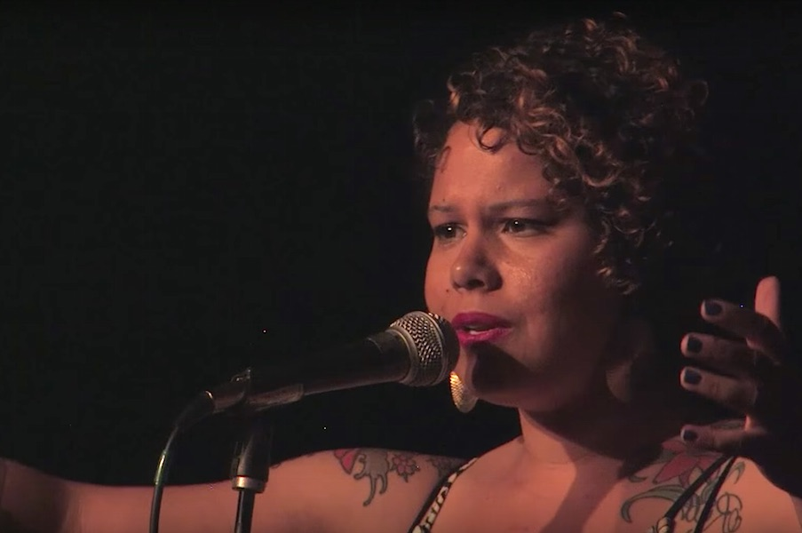 Screenshot from Nikkita Oliver's performance at the 2014 Seattle Poetry Slam in Oakland, Calif., which she won.