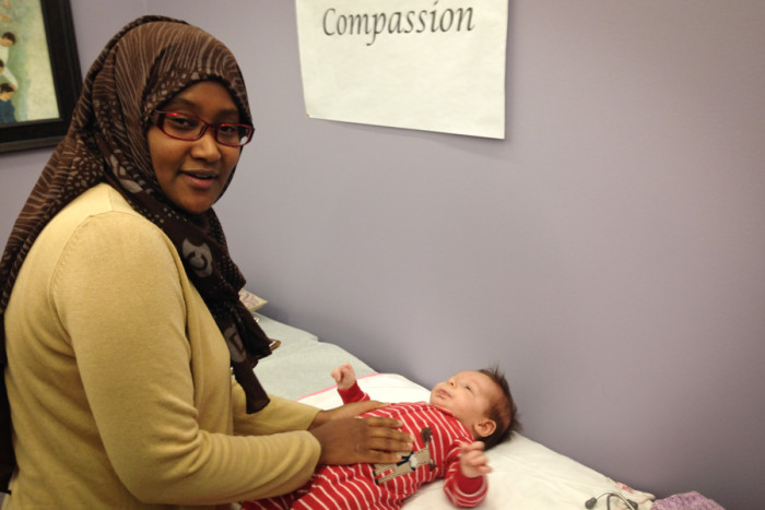 Midwife Faisa Farole examines Malcolm Stonehill (the author's son) at the new Rainier Valley Community Clinic, which offers culturally competent pre- and postnatal health care. (Photo by Sarah Stuteville)