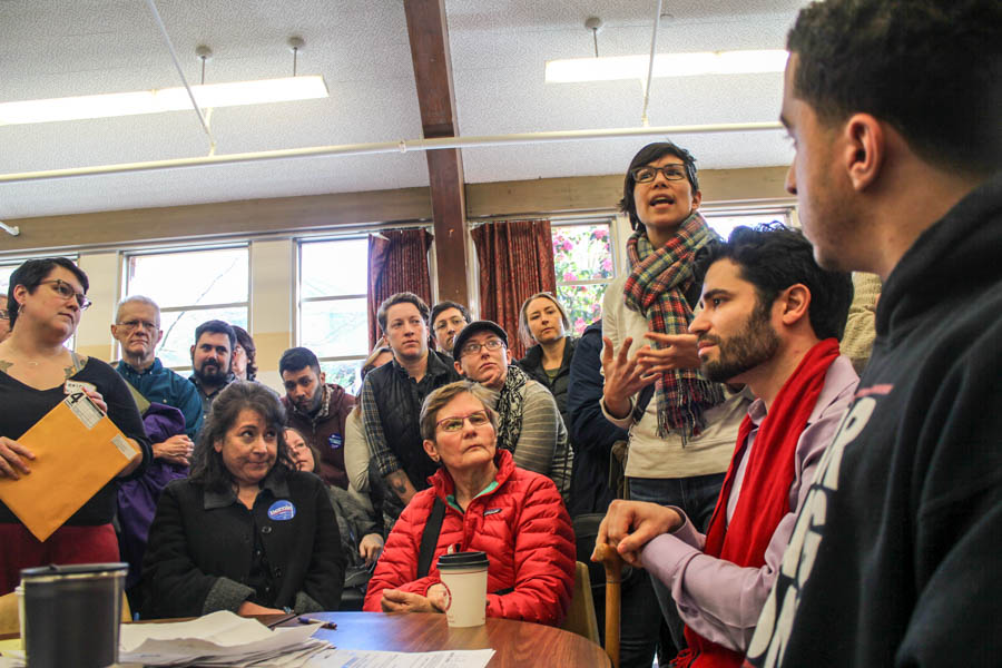 Amarinthia Torres speaks at the Democratic caucus at Lowell Elementary School in Seattle on Saturday (Photo by Sharayah Lane.)