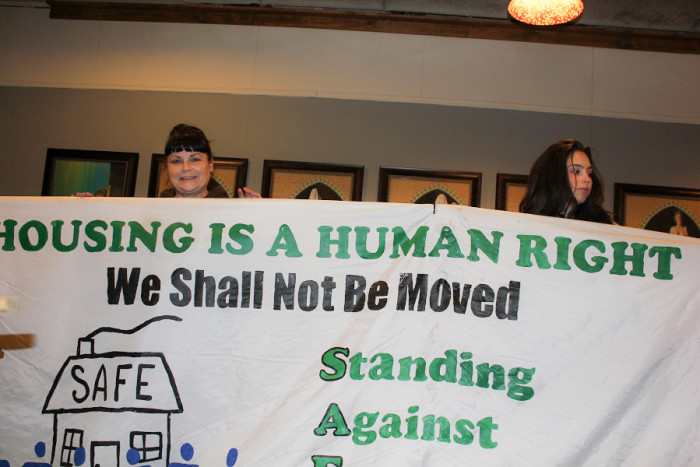 "Pina Belgrano and daughter on Sunday, preparing for the ""Turning the Tables"" action to fight foreclosure of her Beacon Hill home. (Photo by Goorish Wibneh)"