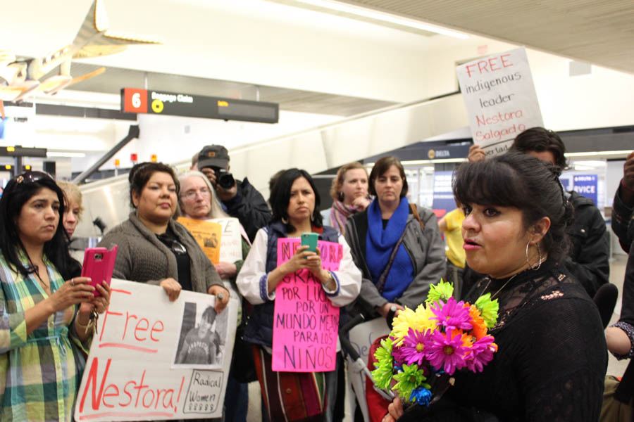 Nestora Salgado (right) addresses her supporters at Seattle-Tacoma International Airport, as she returned to her Renton home after 31 months in jail in Mexico on charges that were dropped this month. (Photo by Venice Buhain.)