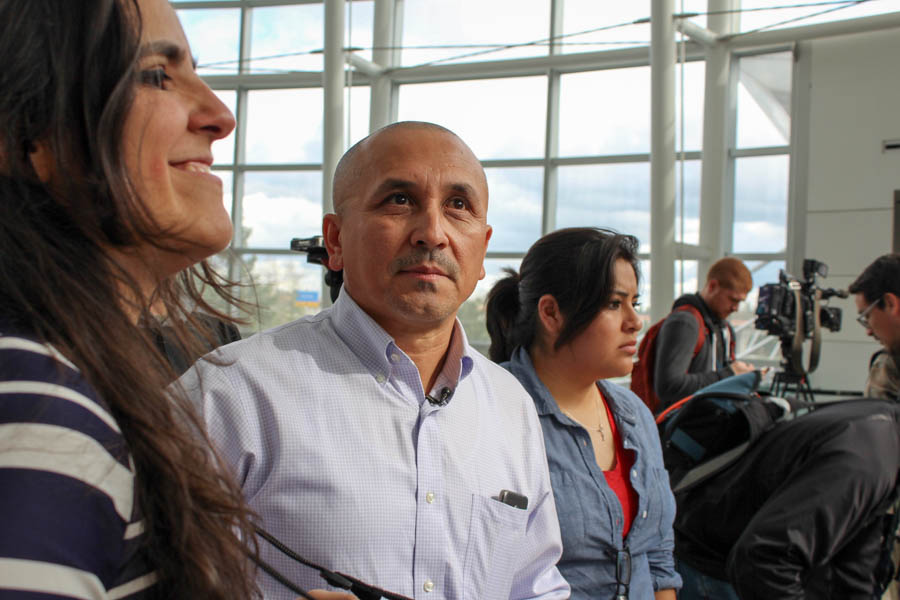 Jose Luis Avila (center) looks pensive as he awaits the return of his wife, Nestora Salgado, who spent 31 months in jail in Mexico. To his right is human rights attorney Alejandra Gonza. (Photo by Venice Buhain.)