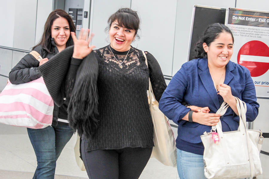 Nestora Salgado (center), accompanied by her daughters, waves at supporters and the press as she returns to Seattle after 31 months in jail in Mexico on charges that were dismissed earlier this month. (Photo by Venice Buhain.)