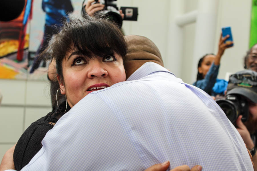 Community police leader Nestora Salgado embraces her husband Jose Luis Avila — the first time they've seen each other in person since she was jailed in Mexico more than two years ago on kidnapping charges that were dismissed this month. (Photo by Venice Buhain.)