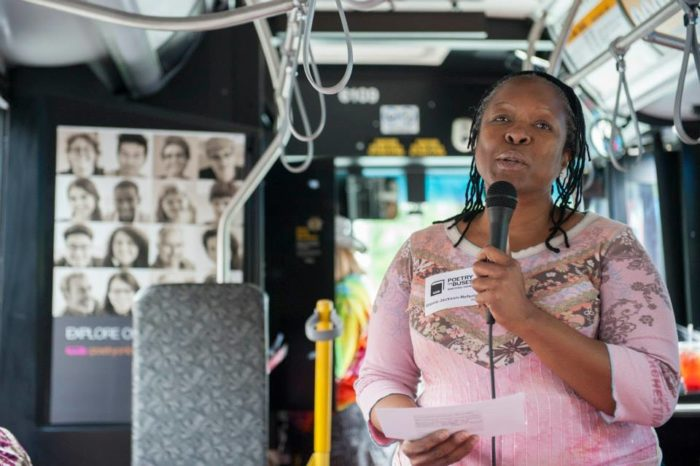 Gloria Jackson-Nefertiti reading her poem about at a Poetry on Buses program at Northwest Folklife. Photo by Timothy Aguero Photography for Poetry on Buses.)