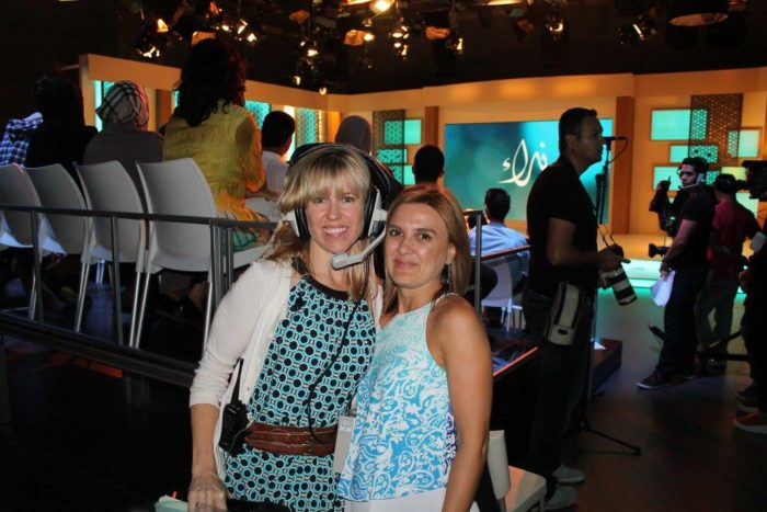 """Producer Suzanne Hayward and another staffer on the set of the """"Nida'a"""" show, an Arab-world talk show. (Photo courtesy Suzanne Hayward.)"""