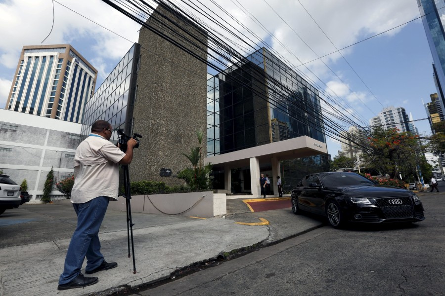 A cameraman is seen outside the Arango Orillac Building where the Mossack Fonseca law firm is situated at, in Panama City, April 4, 2016. (Photo by Carlos Jasso for Reuters.)