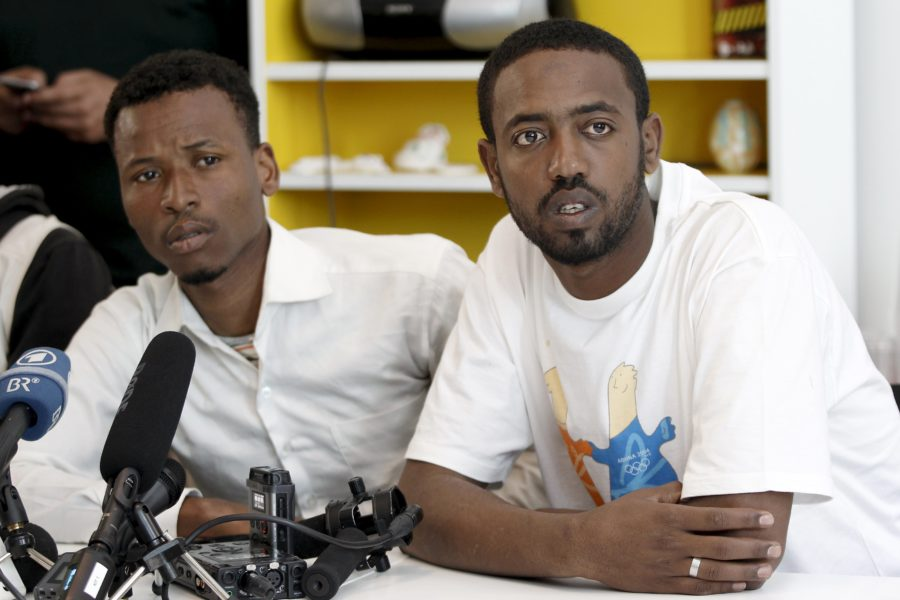 Survivors of recent shipwreck at an unknown location between Libya and Italy, Isman Mowlid of Somalia (L) and Mahmud Muaz of Ethiopia attend a news conference in Athens, Greece, April 21, 2016. (Photo by Michalis Karagiannis for Reuters.)