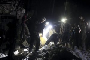 Civil defence members search for survivors after an airstrike at a field hospital in the rebel held area of al-Sukari district of Aleppo, Syria April 27, 2016.  (Photo by Abdalrhman Ismail for Reuters.)