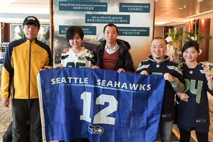 Mariah Zhao (second from left) and other members of a Chinese 12th man meet up group muster smiles after watching the Seahawks Super Bowl loss in 2015. (Courtesy photo)