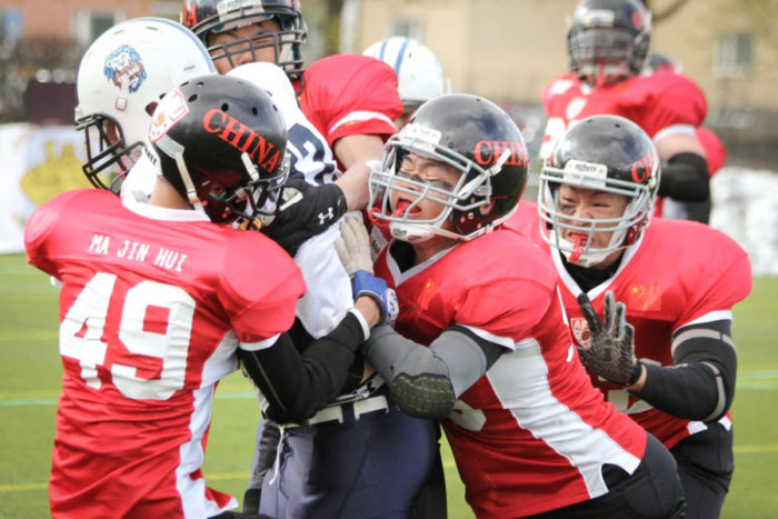 Chinese players take on Finland in the first American Football World University championship in 2014. (Photo from Youtube)