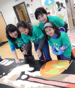 ICHS volunteers painted a mural placed on the wall behind the American Hotel for Spring Clean event 2015