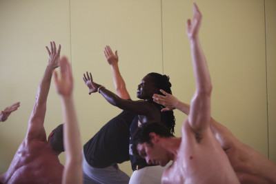 "Irene Auma, seen helping conduct a yoga class in Seattle, grew up in a Nairobi slum and came to yoga through a program called the ""Africa Yoga Project."" (Photo by Ken Lambert / The Seattle Times)"