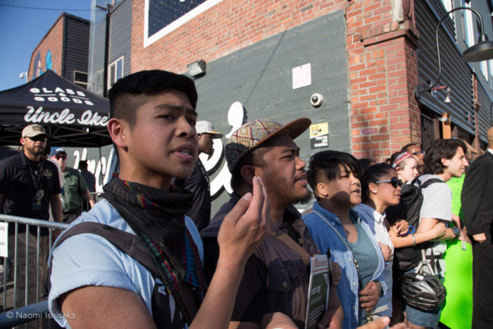 Protesters, including Derek Dizon and Elaine Agoot (second and third from the left) block Union Street side entrance into Uncle Ike's 4/20 party. (Photo by Naomi Ishisaka)