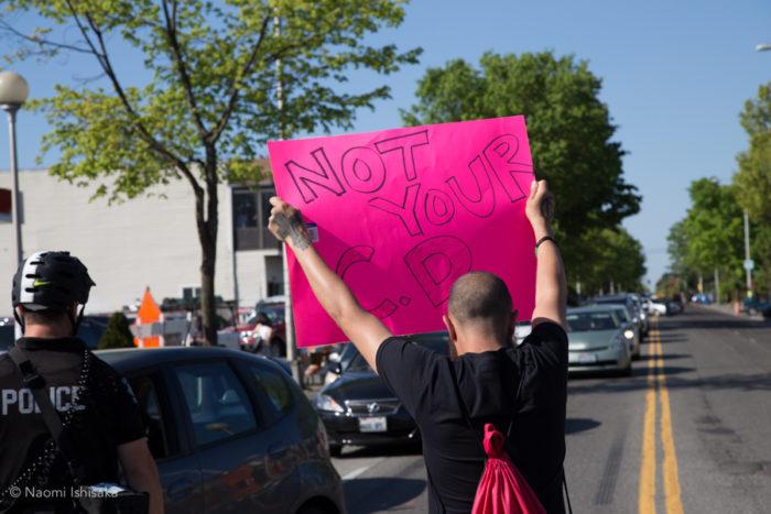 A protester near Twenty-third and Union. (Photo by Naomi Ishisaka)