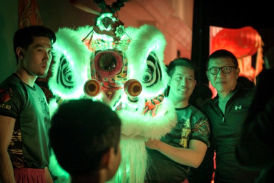 Lion Dance leader Royal Tan with LED lion. (Video still by Seth Halleran)