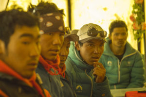 "A still from the movie ""Sherpa"" shows a group of Sherpa attending meeting after the avalanche. Photo courtesy the Discovery Channel.)"